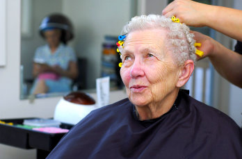 senior woman getting a haircut