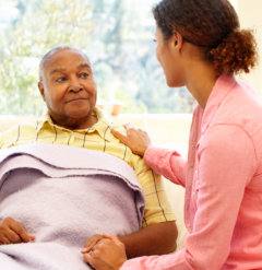 caregiver talking to senior man