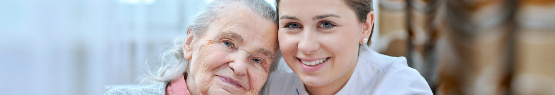 senior woman and caregiver are smiling